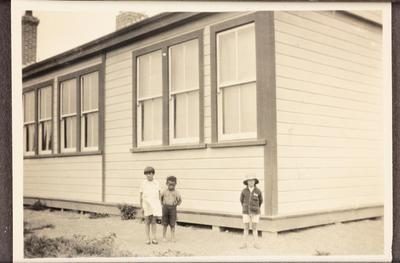 Children by a building