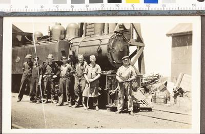 Group portrait with steam engine