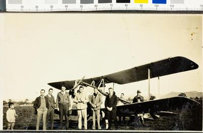Group portrait with a bi-plane