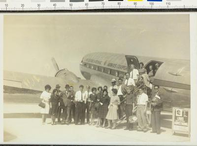 Group portrait in front of a plane