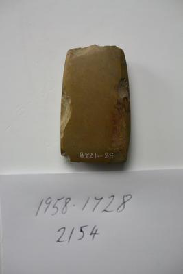 Small chert adze. Chipped on both lateral edges. Chipped on one corner of the blade and along poll end. The largest chip on the poll end is on one corner. Roughly rectangular in shape, the blade end is only slightly wider than the poll end.