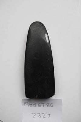 Argillite adze 2A like: quadrangular cross section, no grip modification, distinct unifacial bevel. High polish, one flake off cutting edge on ventral surface. Form is late prehistoric, found throughout North Island and northern quarter of South Island. Chipped on blade.