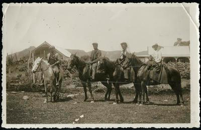 Four People Mounted on Horses