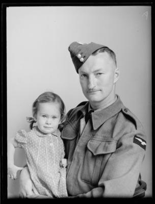 Man in uniform with child