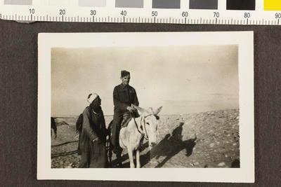 Tom Blair riding a donkey