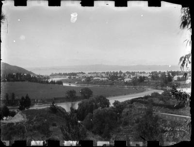 Gisborne from above the Waimata River, 1896. Looking across the river and Score Point to Gisborne and the Bay.