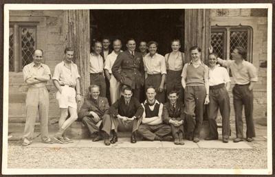 Group of men outside building