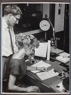 Eileen Cook and unidentified man in Radio 2ZG studio; 42045